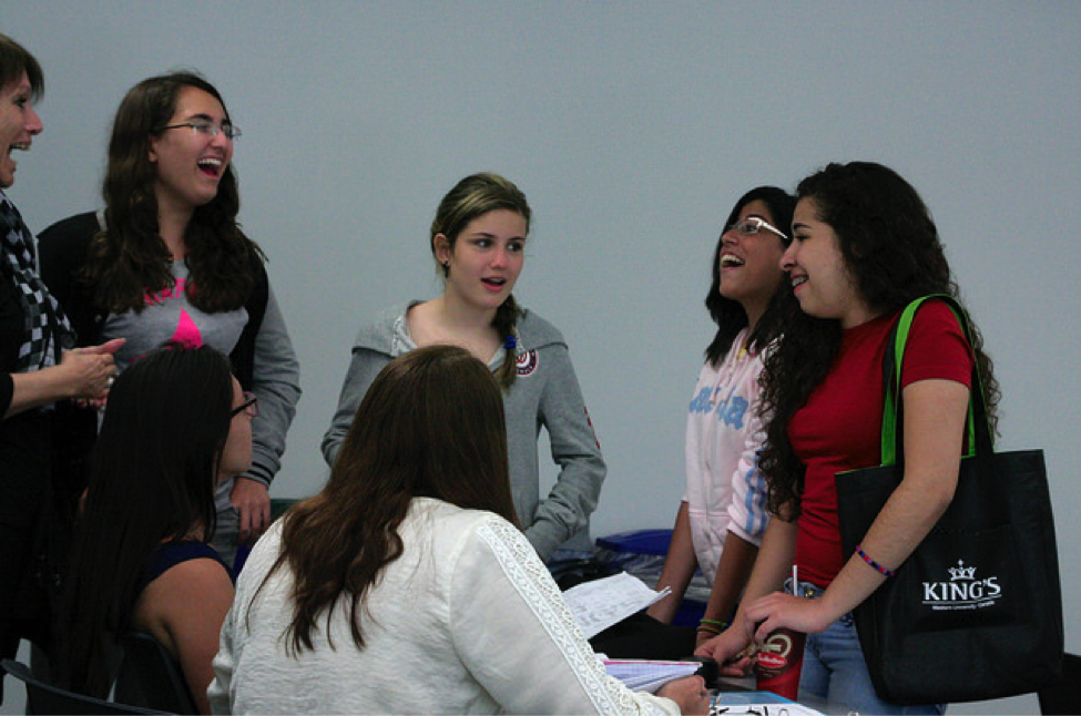 CultureWorks students practice their conversations skills in class