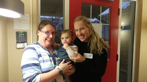 Fellow CW teacher Karen Preston helps out with Meredith and her daughter, Stella.