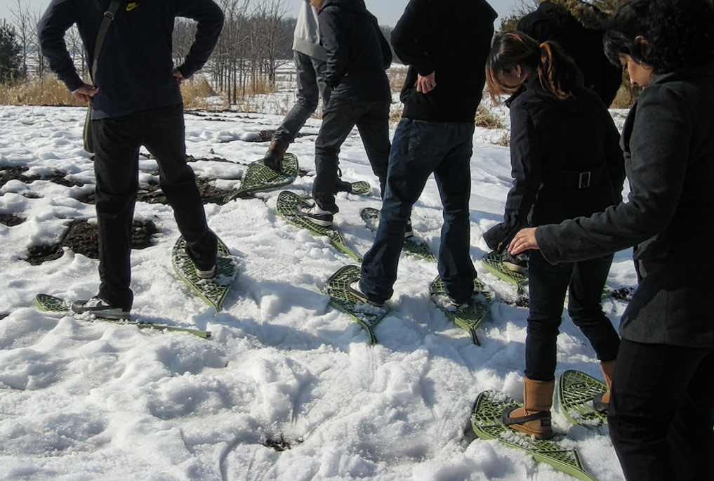 CultureWorks students use snowshoes to walk on the snow!