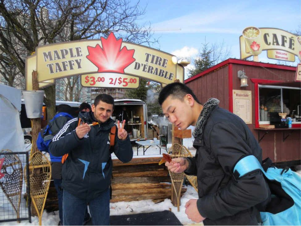 CultureWorks students enjoy a maple taffy treat while they skate along the Rideau Canal