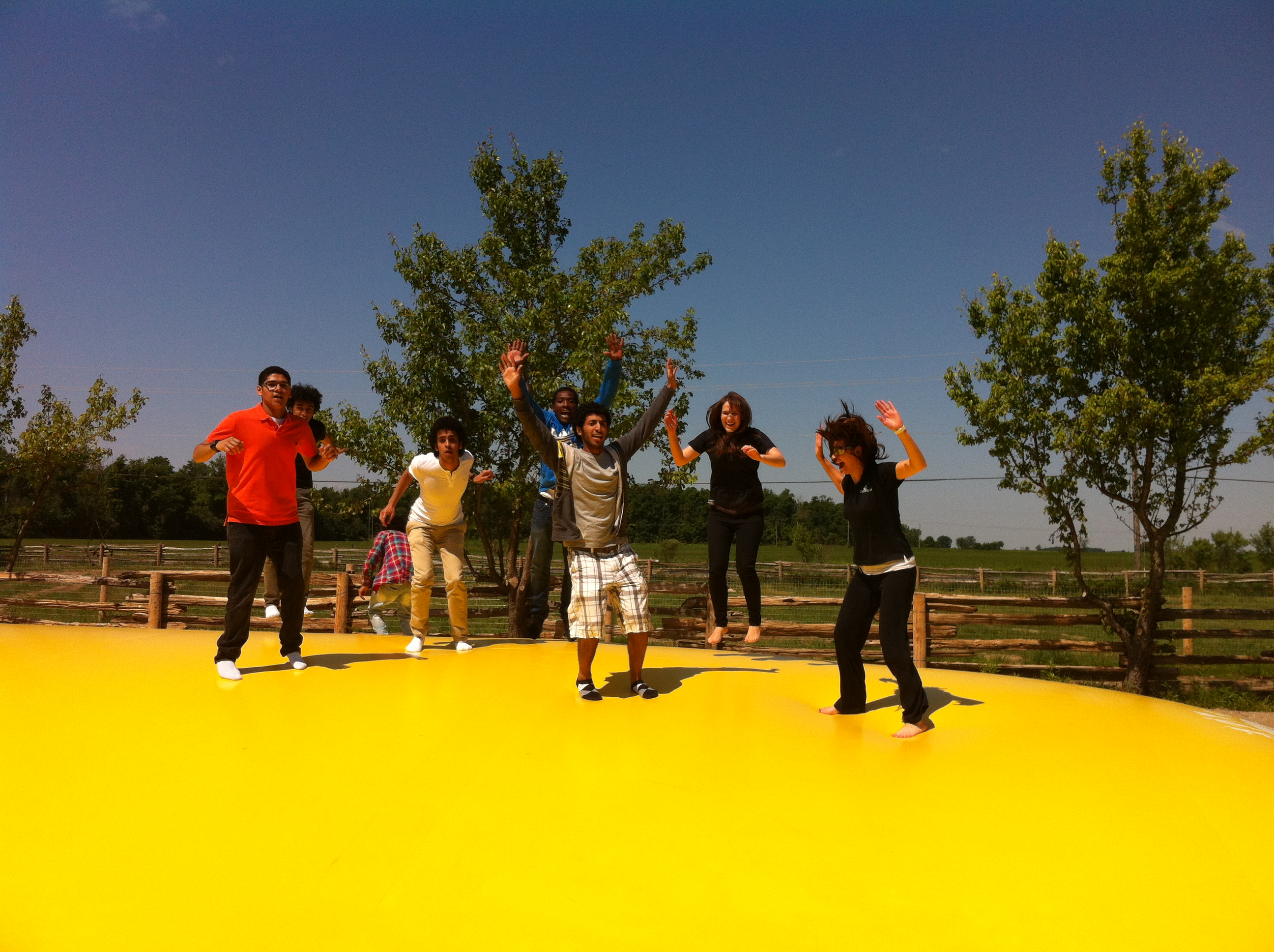Students and teachers enjoy the giant jumping pillow at Clovermead Adventure Farm