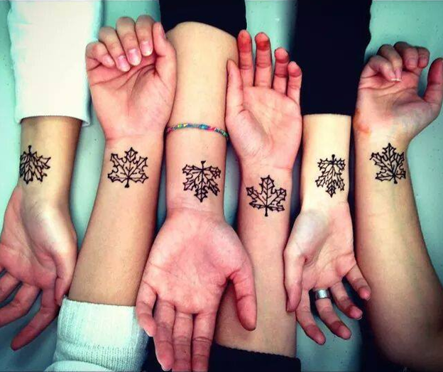 CultureWorks English as a Second Language students show off cool henna maple leaves