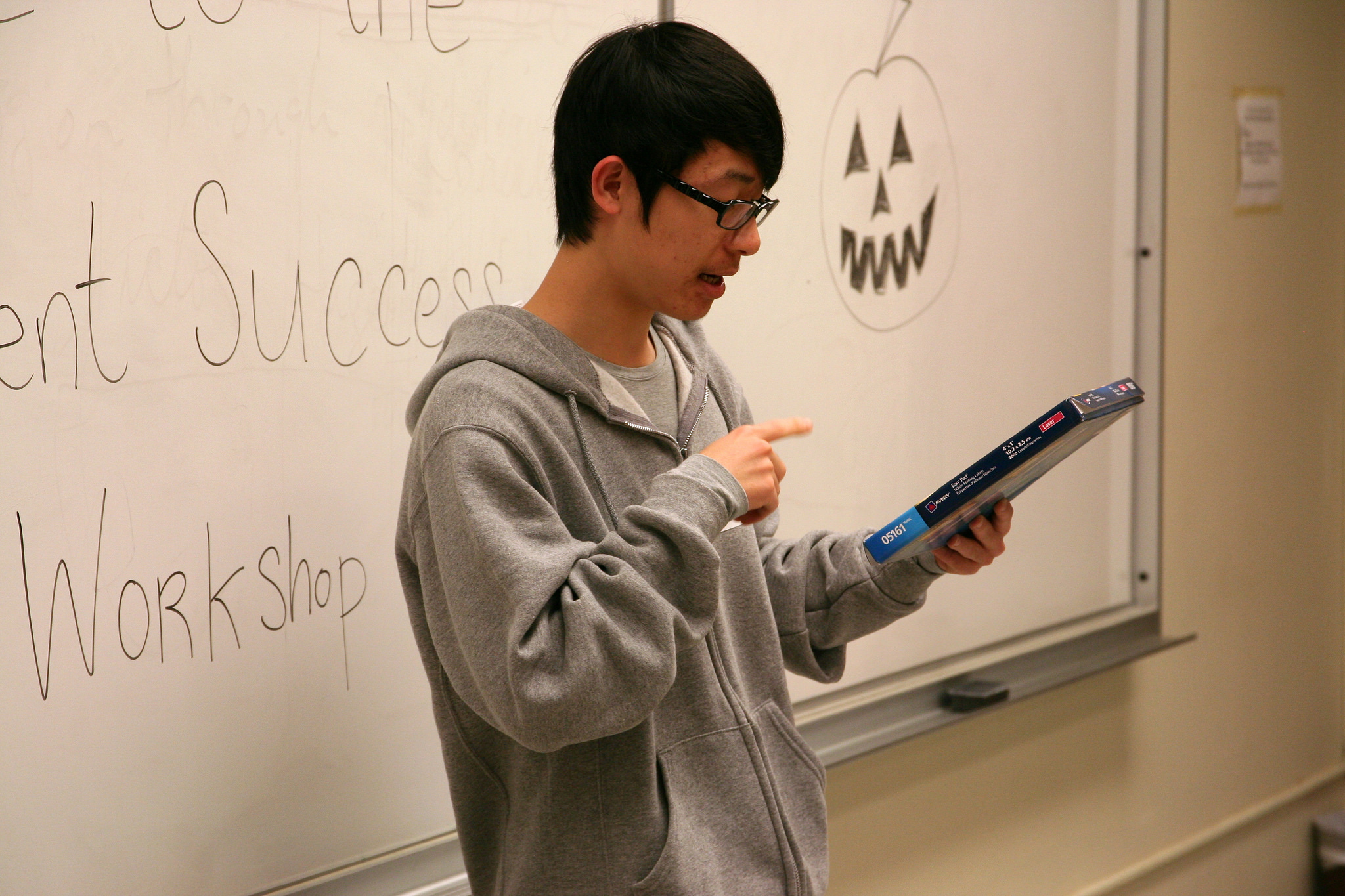 A CultureWorks student practices their pronunciation in a fun class exercise