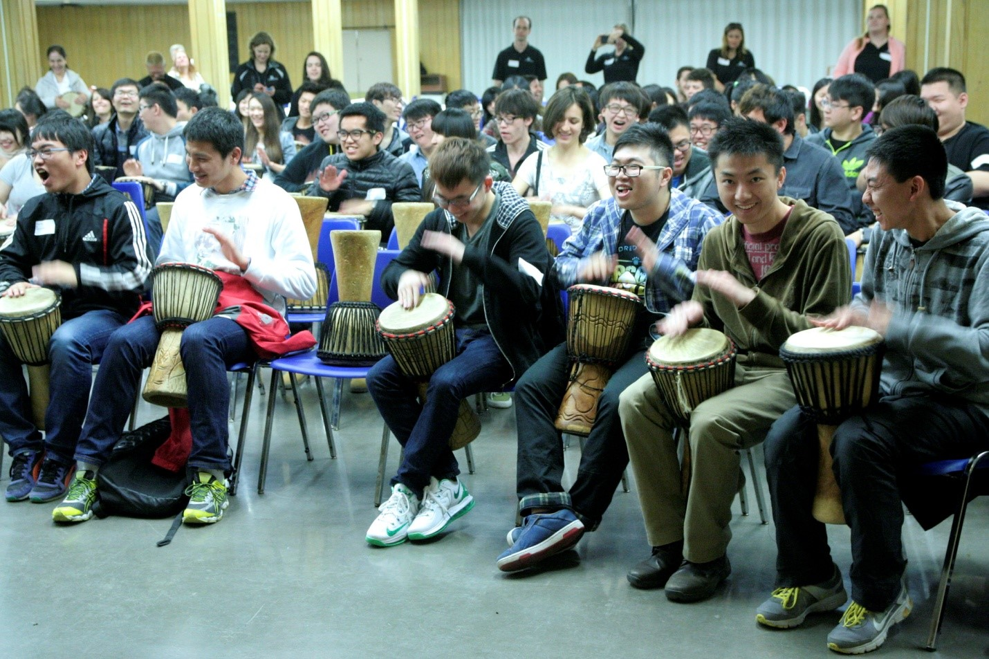 CultureWorks students play the bongos during the opening ceremonies at the London campus
