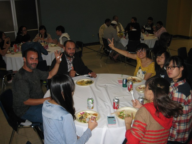 CultureWorks students eat a tasty meal during our potluck