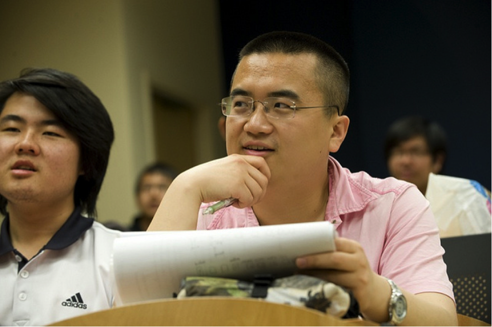 A CultureWorks student listens closely while taking notes in class