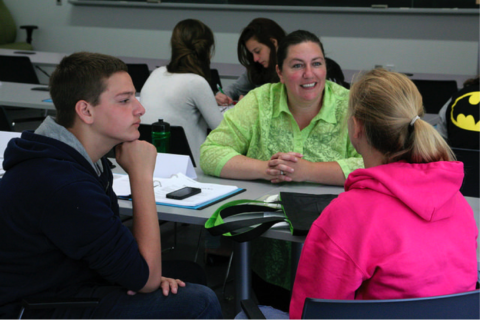 A CultureWorks instructor helps students one-on-one at the King's University campus
