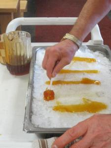 Layering the syrup to freeze on ice.